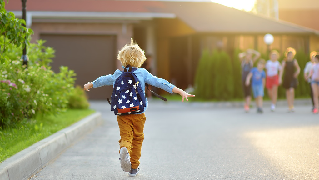 Child running with backpack